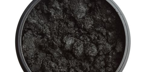 Whiten teeth with charcoal paste