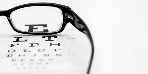 aspirin linked to vision loss; eyeglasses and eye exam chart
