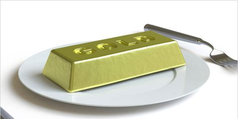 vulnerability can trigger overeating; block of gold on a plate