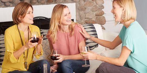 Smile, Wine glass, Sitting, Drink, Tableware, Drinkware, Comfort, Stemware, Sharing, Barware,