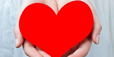 self-esteem tips; woman holding paper heart