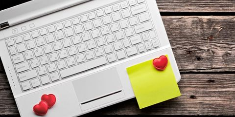 online dating tips; laptop with heart-shaped magnets