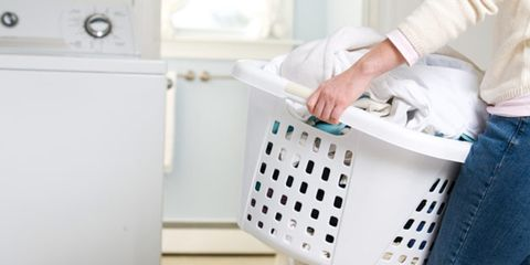 Laundry dried inside can cause health problems; woman with laundry
