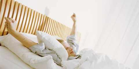 Natural sleep supplements that work; woman waking rested
