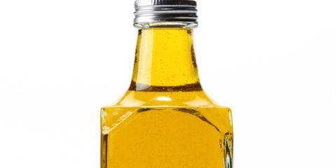 Liquid, Yellow, Bottle cap, Bottle, Glass bottle, Drink, Fluid, Amber, Drinkware, Oil,