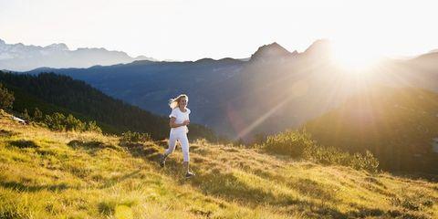 Grass, Mountainous landforms, Hill, Grassland, Highland, People in nature, Mountain, Mountain range, Sunlight, Sun,