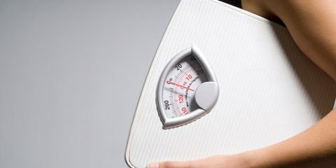brown fat boosts metabolism and calorie burn; woman with scale