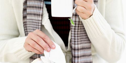 Bronchitis can develop from cold or flu; sick woman