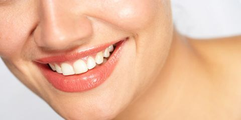 Smiling reduces physical stress response; woman smiling