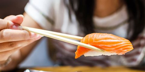 Fish fraud is common at restaurants and grocery stores; woman eating sushi