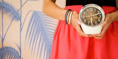 quick health tricks; woman holding a clock