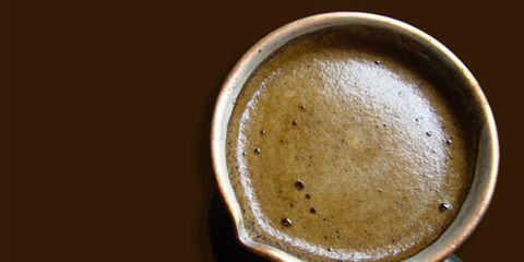 Brown, Serveware, Kitchen utensil, Circle, Still life photography, Coffee, Single-origin coffee, Cup, Brass,