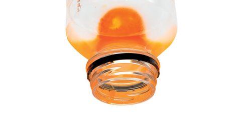Liquid, Orange, Glass, Automotive lighting, Fluid, Amber, Bottle, Peach, Automotive light bulb, Incandescent light bulb,