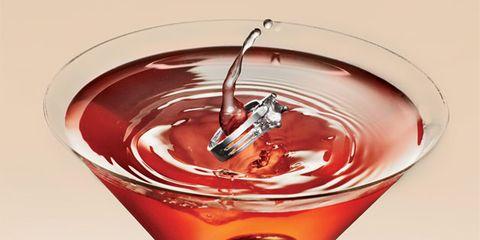 Liquid, Fluid, Drink, Barware, Glass, Amber, Alcoholic beverage, Cocktail, Logo, Drinkware,