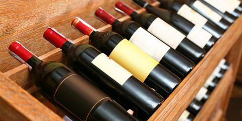 wine temperature influences taste; wine bottles on a shelf