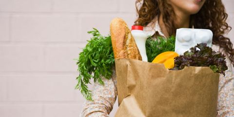 unusual food items are tasty and nutritious; woman with groceries