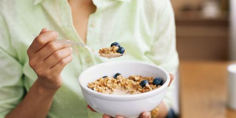 Organic milk industry is growing; woman eating cereal with milk