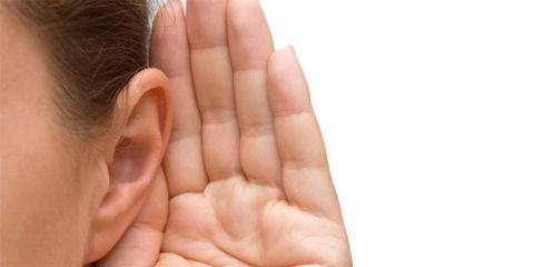 Diabetes has been linked to hearing loss; woman trying to hear