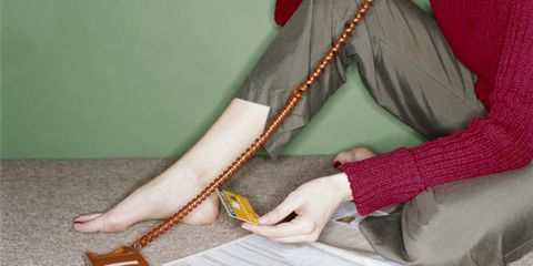 Sadness can cause impulsive spending; woman with credit card