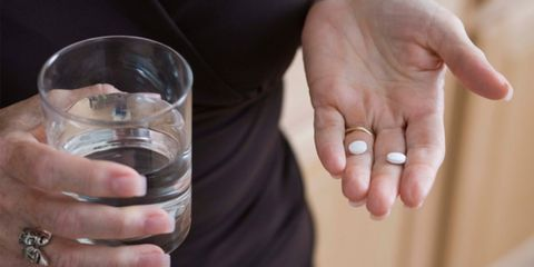 Aspirin with coating may not be effective for heart health; woman taking aspirin