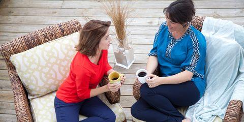 Human, Comfort, Sitting, Sharing, Lap, Conversation, Handbag, Living room, Pillow, Couch,