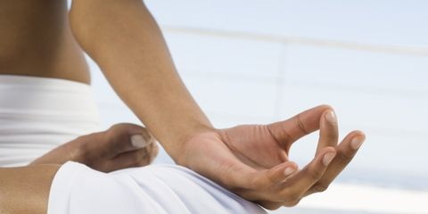 meditation can enhance sex life; woman meditating