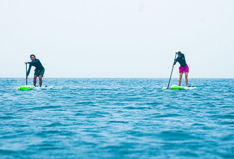 Stand up paddle surfing, Water, Surface water sports, Ocean, Surfing Equipment, Wave, Sea, Water sport, Sky, Recreation,