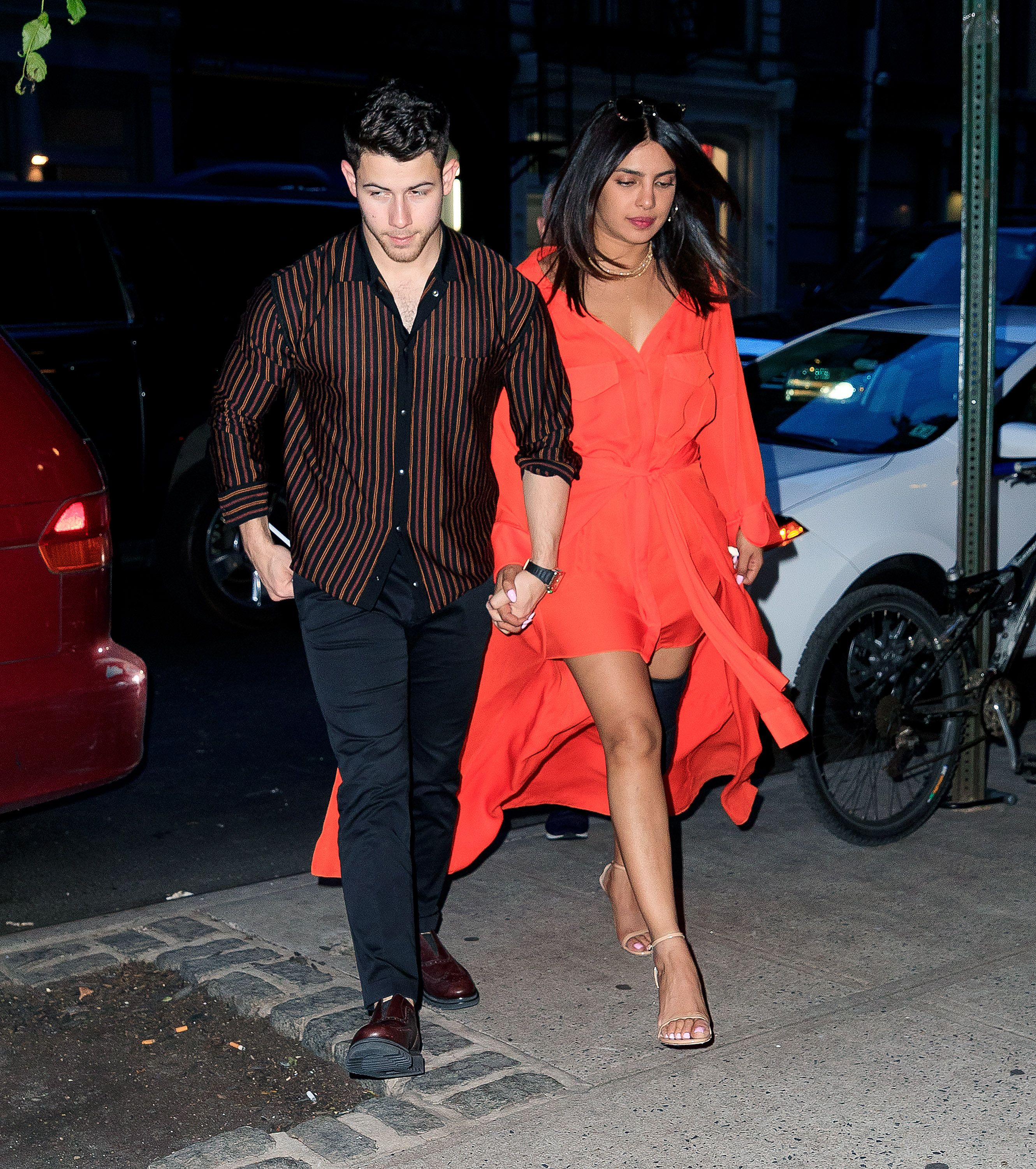Priyanka Chopra Wears Orange Dress and Knee Brace For Date Night With Nick Jonas