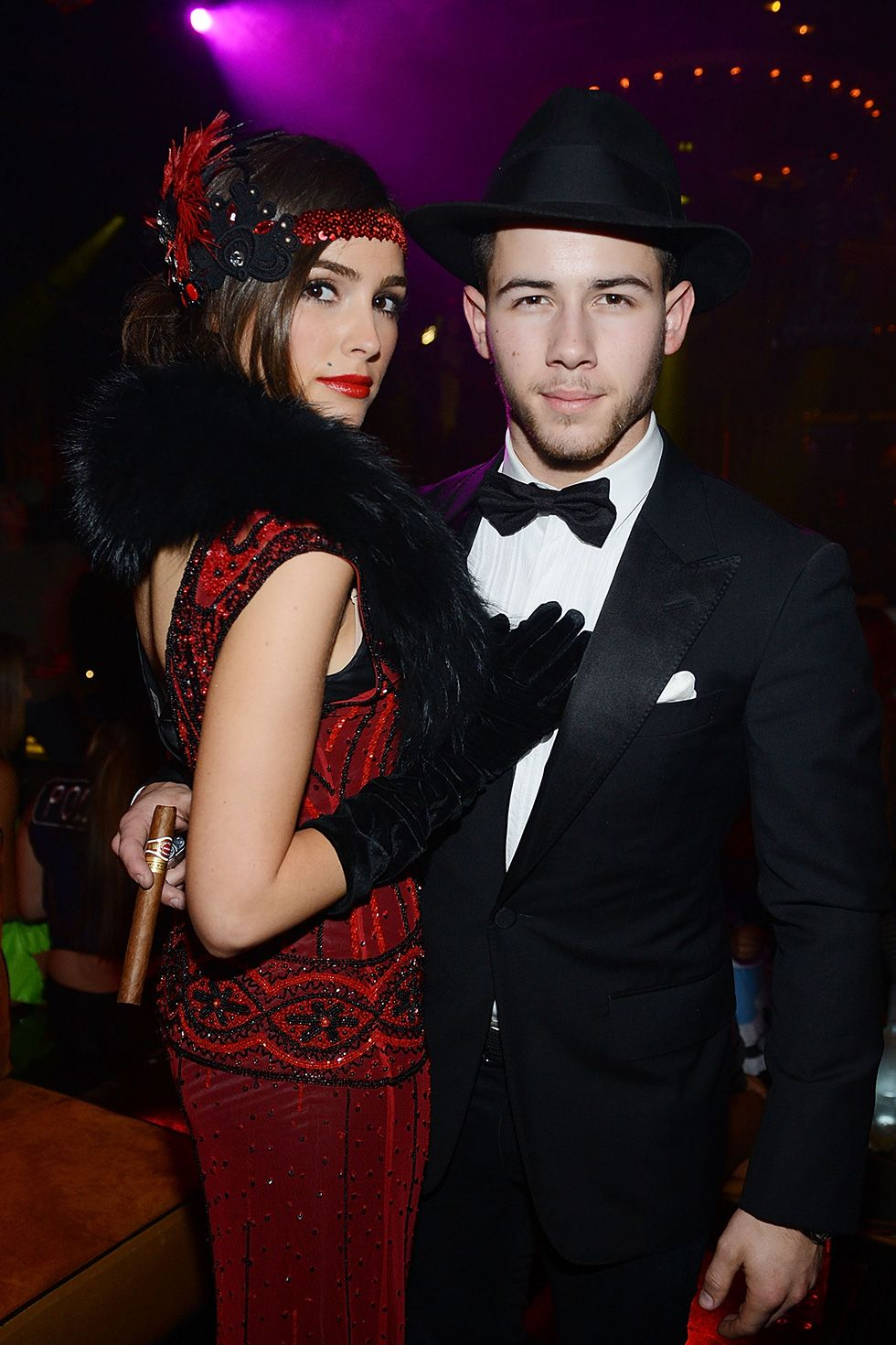 Olivia Culpo and Nick Jonas - 1920s Folks In 2014, Olivia Culpo and Nick Jonas rocked their best 1920s flapper and mobster look for the Halloween costume party contest at the Mirage Hotel and Casino in Las Vegas, Nevada.