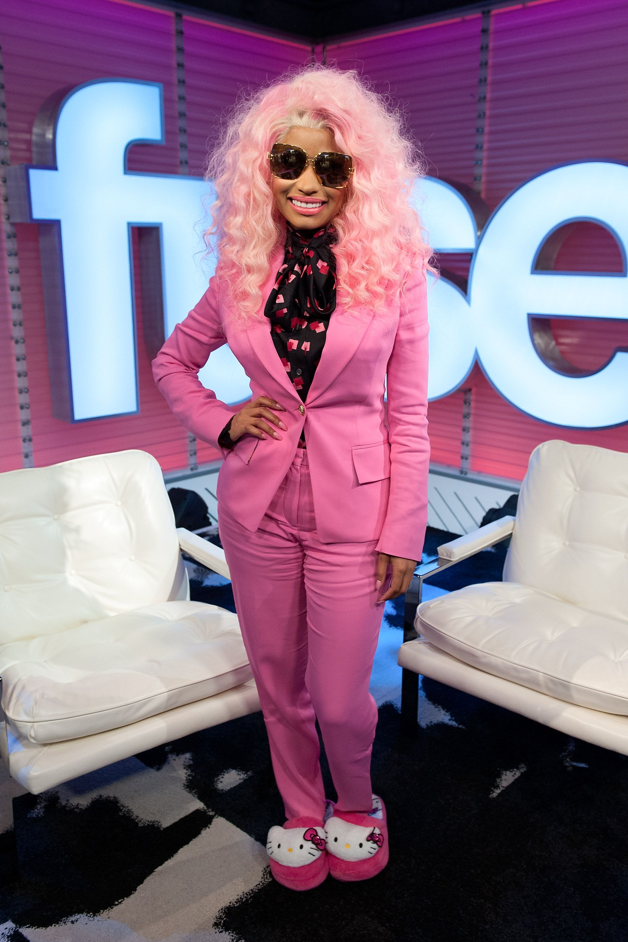 "Nicki Minaj Nicki Minaj visited fuse's ""Top 20 Countdown"" in a pink suit and Hello Kitty...slippers? The kawaii shoes matched the color palate Minaj had going for the day."