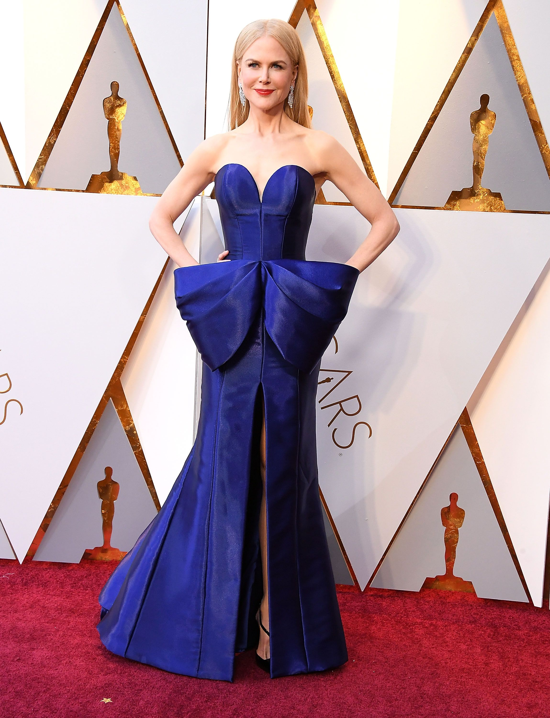 Kidman wore a show-stopping cobalt Armani Prive gown with a structured silhouette and oversized bow embellishment for the 90th annual Academy Awards.