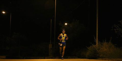 Dean Karnazes running with a headlamp at night
