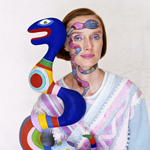 french american sculptor, painter, and filmmaker niki de saint phalle with one of her pieces, 1983