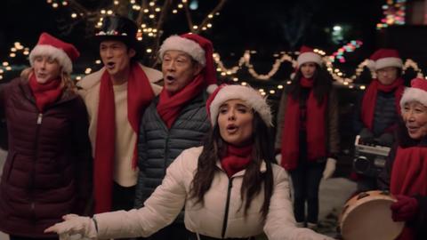 people singing in santa hats