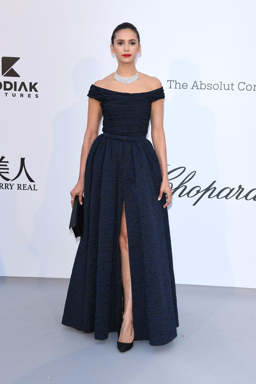 Nina Dobrev In a navy off-the-shoulder A-line gown.