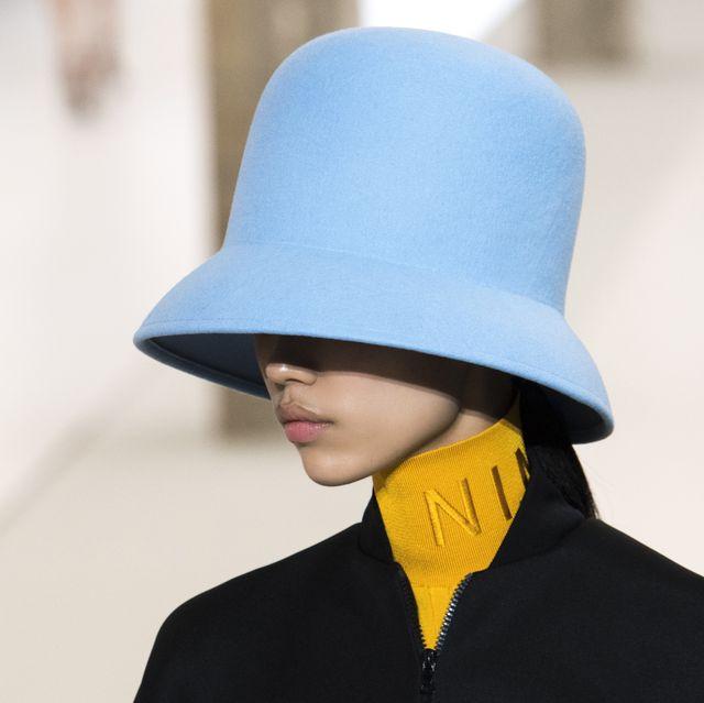 Clothing, Hat, Blue, Street fashion, Yellow, Fashion, Fedora, Fashion accessory, Headgear, Sun hat,