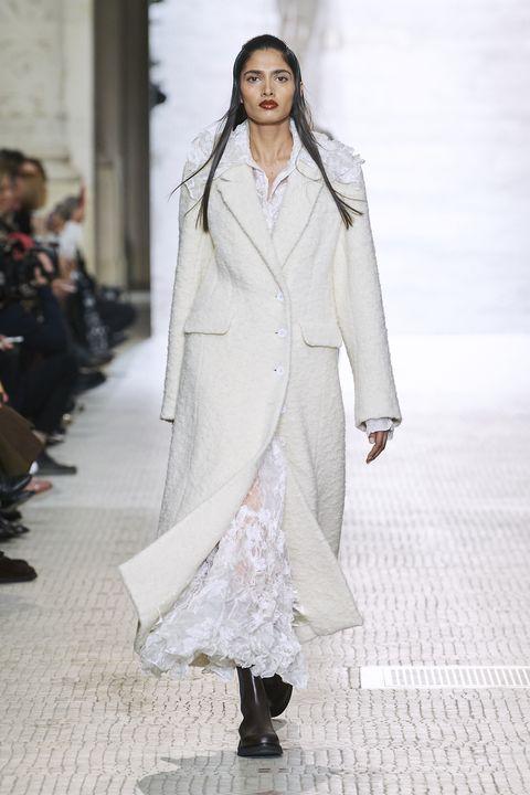 Fashion, Fashion model, Fashion show, Runway, White, Clothing, Haute couture, Public event, Outerwear, Fashion design,
