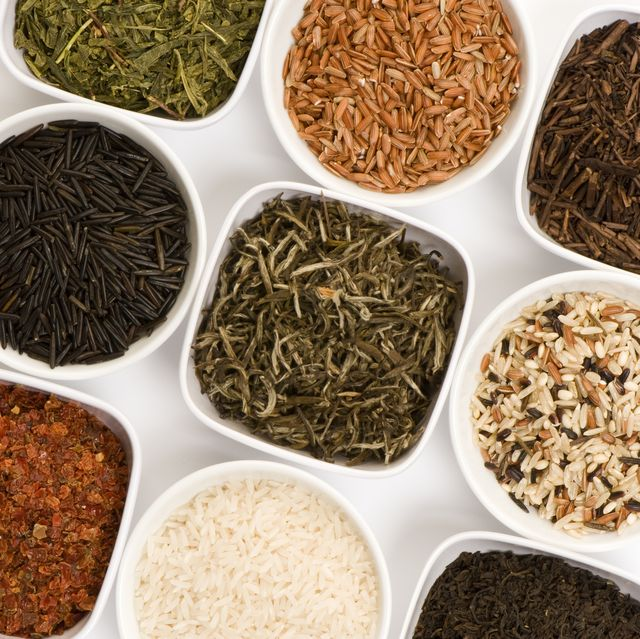 nine small dishes with colorful tea leaves and rices