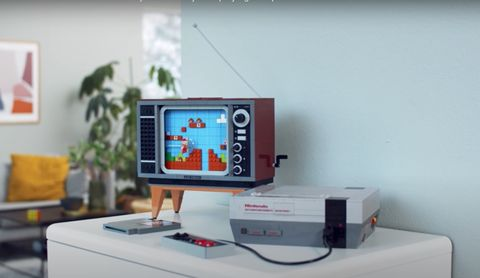 nintendo lego nes kit with mini tv showing a mario game on the screen and, mini nes, both made out of lego