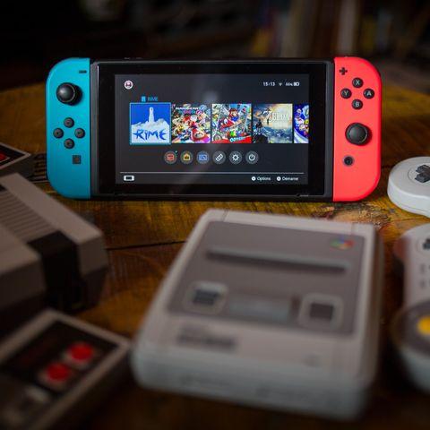 A Nintendo Switch next to SNES