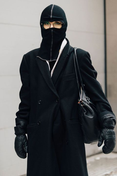 Black, Outerwear, Clothing, Overcoat, Coat, Headgear, Costume, Hood, Jacket, Trench coat,