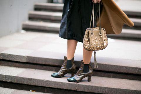 Brown, Shoe, Human leg, Stairs, Textile, Outerwear, White, Bag, Style, Street fashion,