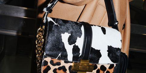 Shoulder, Fashion, Handbag, Bag, Fashion accessory, Leather, Joint, Fashion model, Waist, Hand,