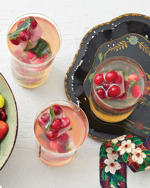 white grape punch with cranberry ice with christmas ribbon on side