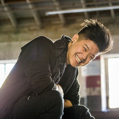 Portrait of laughing androgynous Asian man
