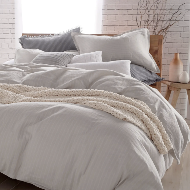 bed with striped bedding