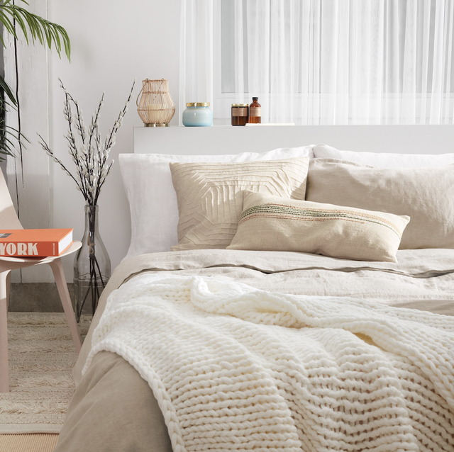 bedroom with neutral bedding and decor