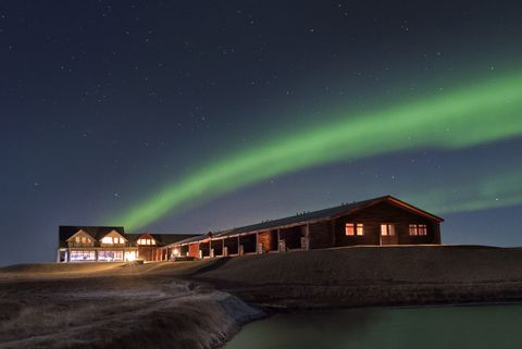 Sky, Aurora, Night, Light, House, Atmosphere, Architecture, Cloud, Landscape, Geological phenomenon,