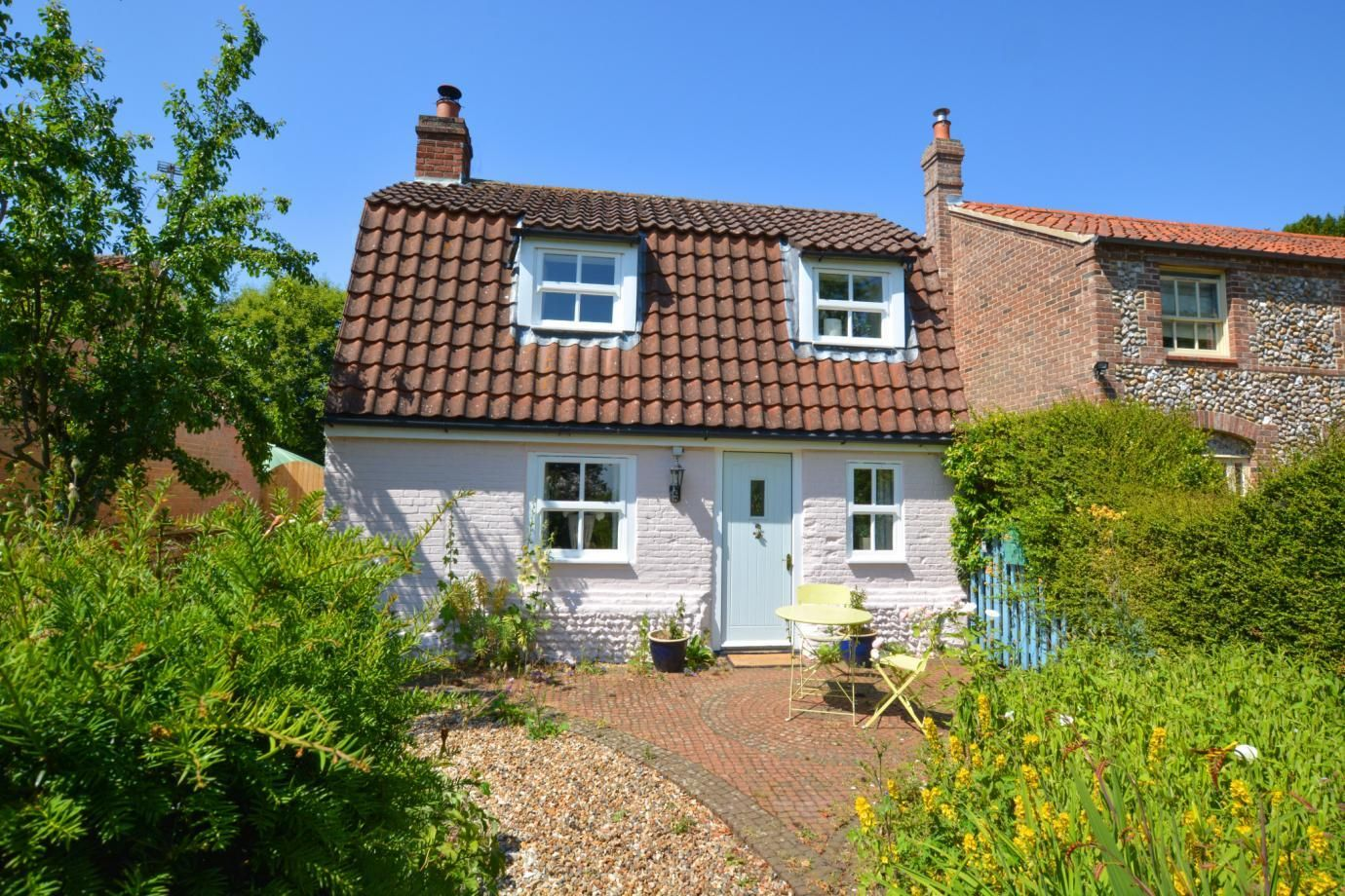This charming pink cottage to rent in Norfolk is perfect for a romantic staycation
