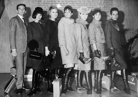 pierre cardin with models at airport